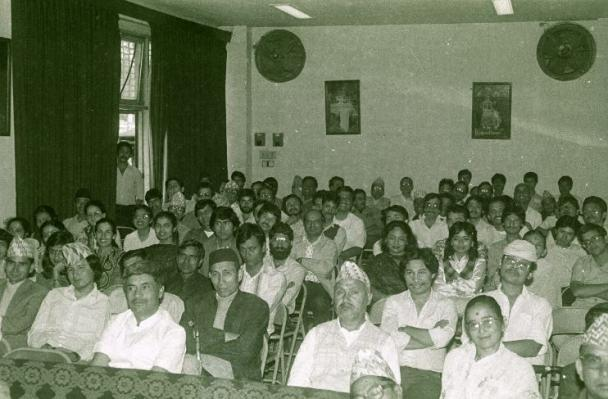 Photograph of an audience sat watching a talk or performance
